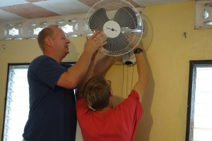 Tim and Jonah repair fan