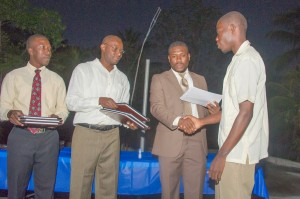 Receiving his certificate of completion from IIT Haiti