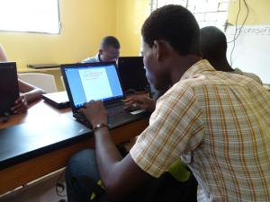 Adults learning at IIT Haiti